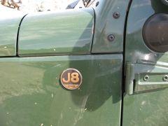 J8 badge